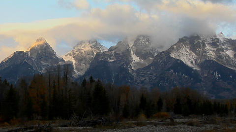 Clouds move across the Grand Teton mountain range Stock Video Footage
