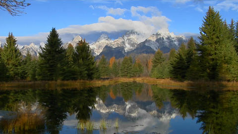 The Grand Teton mountains are reflected in a lake Stock Video Footage
