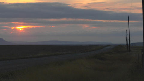 A rural road passes under a multi-colored sky Stock Video Footage