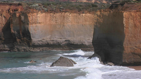 Waves crash on a rugged coastline in Australia Stock Video Footage