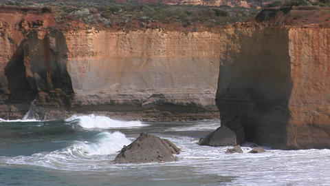 Waves crash on a rugged coastline in Australia Footage