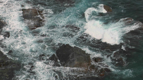 Waves crash over rocks Stock Video Footage