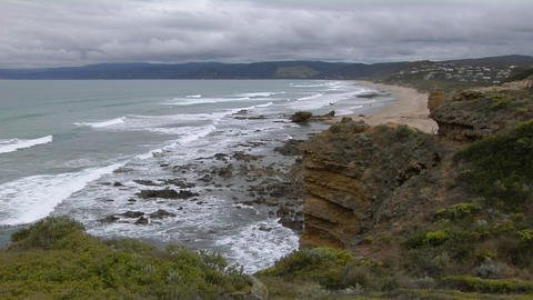 Waves roll onto the rugged coastline of South Victoria, Australia Footage