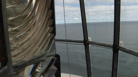 An unlit light rotates in a lighthouse Stock Video Footage