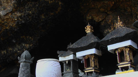 Bats fly in and out of a large cave in Bali, Indonesia Stock Video Footage