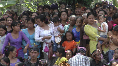 A crowd of women and children stand together in Indonesia Live Action