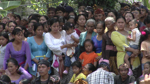 A crowd of women and children stand together in Indonesia Stock Video Footage