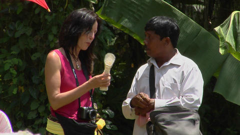 A tourist and a merchant discuss an object in Indonesia Stock Video Footage