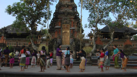 Girls practice the legong dance at a Balinese dance school Stock Video Footage