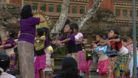 A woman leads a group of girls in dance movements at an... Stock Video Footage
