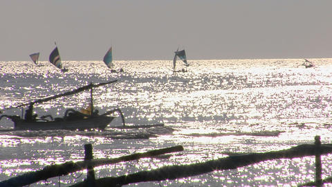 Small boats move across the shimmering ocean Stock Video Footage