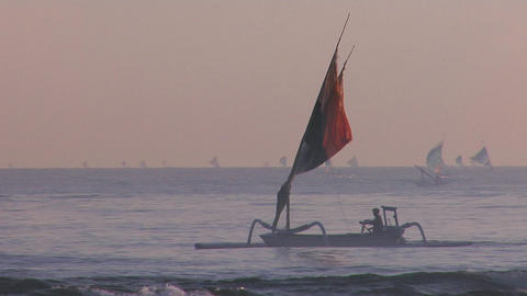 People row a fishing boat to into shore off the coast of... Stock Video Footage
