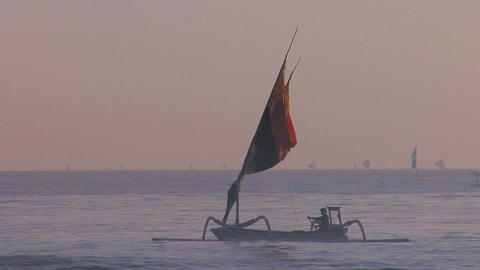 People row a fishing boat to into shore off the coast of Southeast Asia Footage