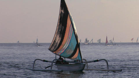 A catamaran-style fishing boat moves into shore Stock Video Footage