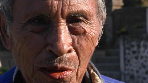 An elderly Asian man smiles Footage
