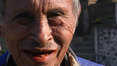 An elderly Asian man smiles Stock Video Footage