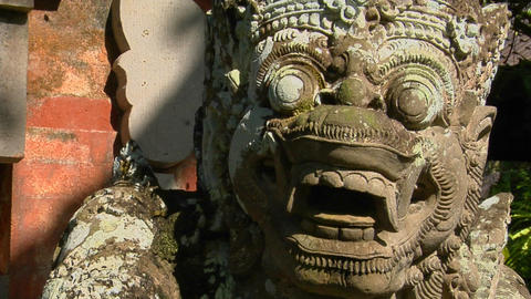 A Balinese God stone carving guards a temple Footage