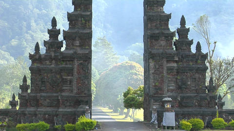 The fog drifts by a traditional Balinese temple gate in... Stock Video Footage