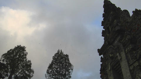 The clouds pass over a Balinese temple in Bali, Indonesia Stock Video Footage