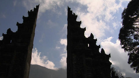 The clouds pass over a Balinese temple gates in Bali, Indonesia Footage