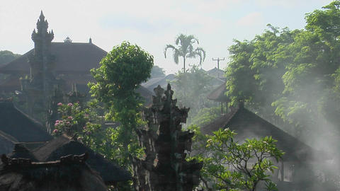 Trees stand in front of a temple in Bali, Indonesia Stock Video Footage