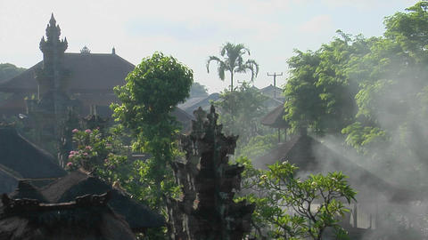 Trees stand in front of a temple in Bali, Indonesia Live Action