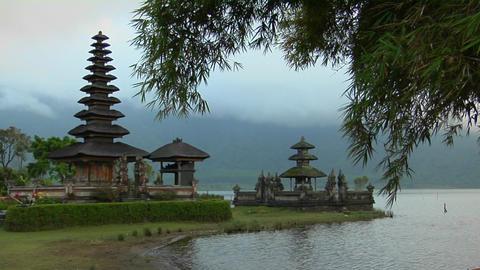 Morning fog and mist surround the Ulun Danu temple in Lake Bratan, Bali, Indonesia Footage