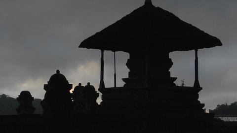 A Balinese temple stands in silhouette Footage
