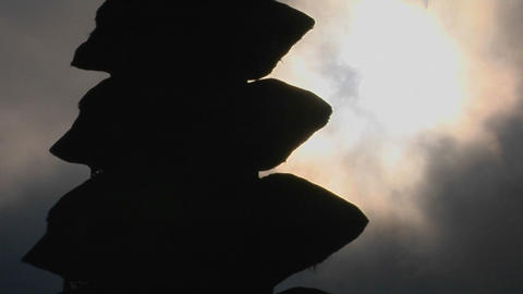 Part of a Balinese temple stands in silhouette Footage