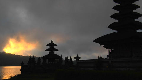 A Balinese temple overlooks reflections in a lake Stock Video Footage