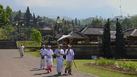 A religious procession passes by Besakih Temple in Bali, Indonesia Footage