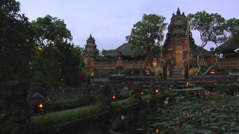 A beautiful Balinese temple has a pond of lily pads in front Footage