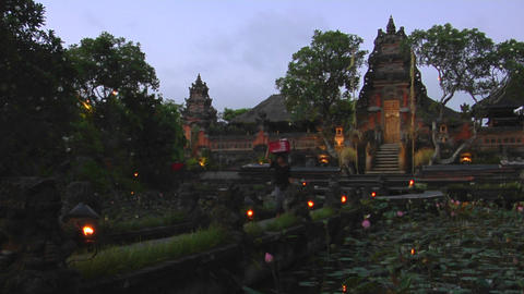 A woman walks on the grounds of a Balinese temple,... Stock Video Footage