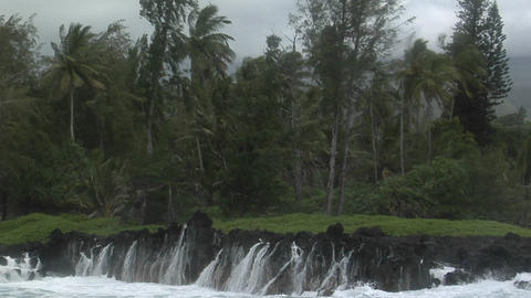 A large Pacific storm batters a tropical island with large waves Footage
