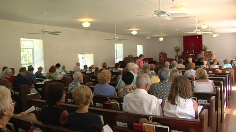 The interior of a small town church with many worshippers Stock Video Footage