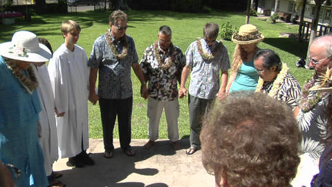 A prayer circle of Hawaiian worshippers outside a church Stock Video Footage