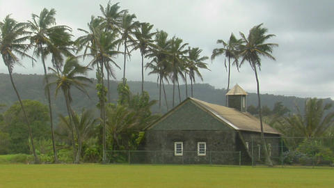 A church stands on a tropical island during a wind storm Footage