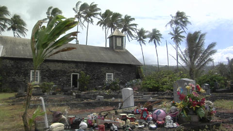 Wind blows over a heavily decorated grave on a tropical... Stock Video Footage