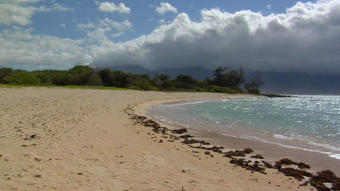 Waves roll into a white sand beach in Hawaii Stock Video Footage