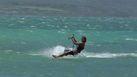 Windsurfers glide across a sparkling ocean Footage