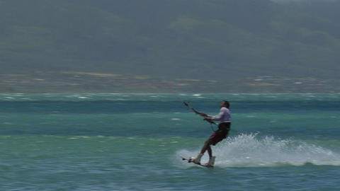 A windsurfer glides along the ocean Footage