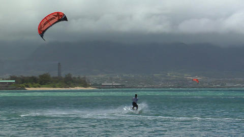 A windsurfer glides along the ocean Stock Video Footage