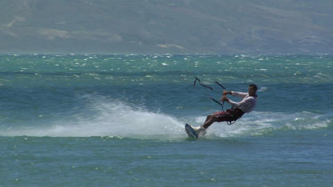 A windsurfer glides along and makes a sudden turn Stock Video Footage