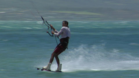 A windsurfer glides along and makes a sudden turn Footage