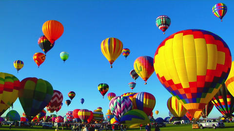 Pan across beautiful balloons launching at the Albuquerque balloon festival Footage