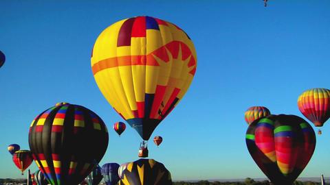 Balloons float across the sky at the Albuquerque balloon... Stock Video Footage