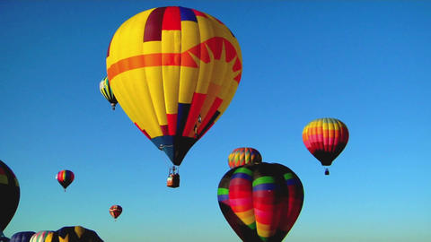 Balloons float across the sky at the Albuquerque balloon festival Footage