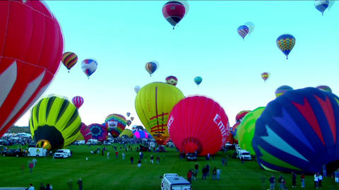 Time lapse shot of balloons filling and rising at the Albuquerque Balloon Festival Footage