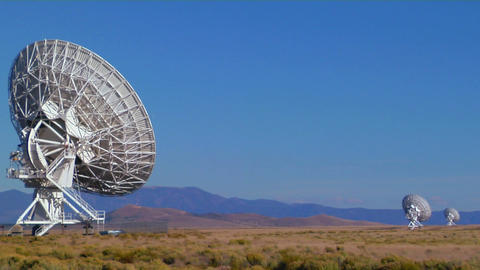 Satellite dishes are lined up on a lonely plain Stock Video Footage