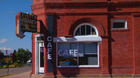 A cafe in a one story brick building Stock Video Footage